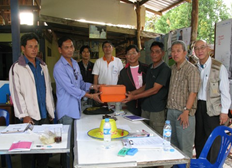 Representatives from Thaioil present survey equipment for the use of projects in Village Development Project.